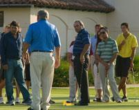 Golfers listening to instruction